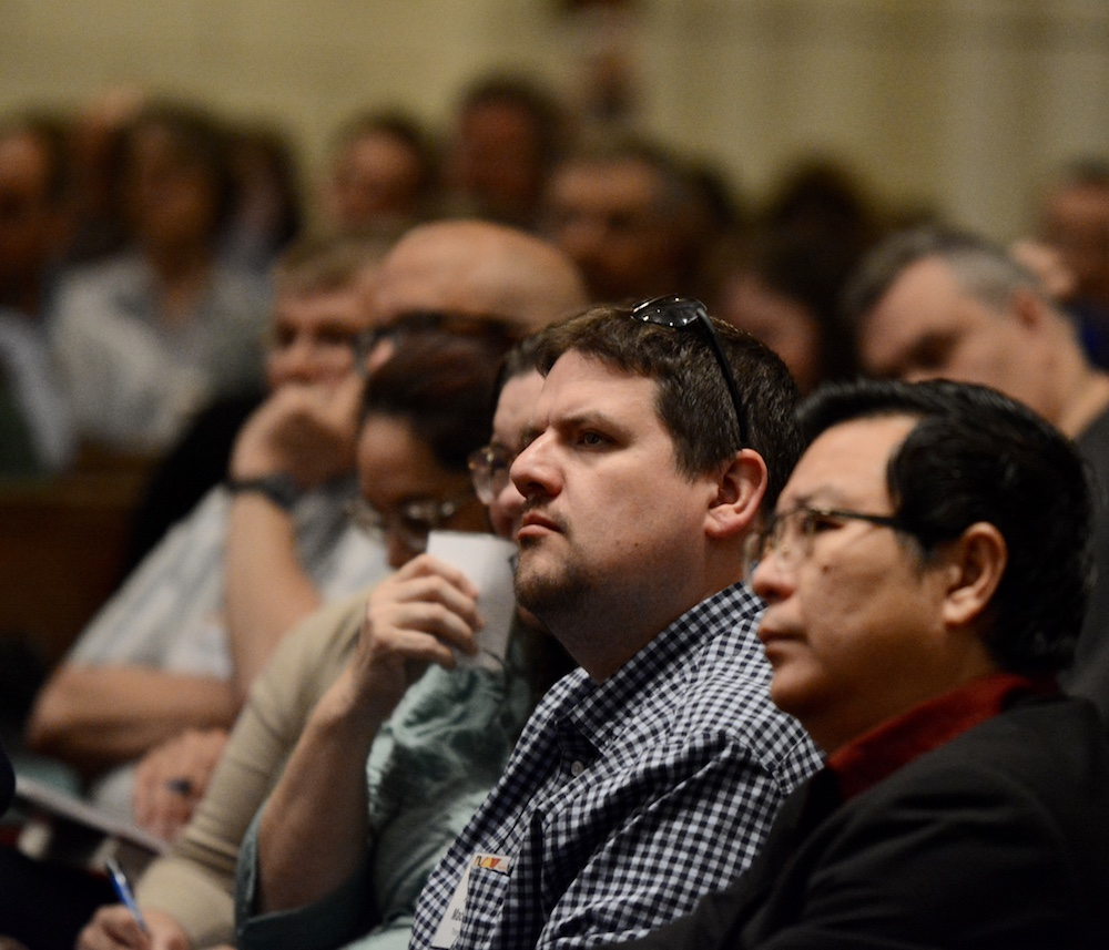 attendees engaged with a homily